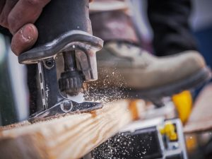 Wood Construction Tool :construction, tool, saw, cut, cutting, reciprocating saw, labor, heavy duty, building, creating, professional, sharp, material, technology, power tool, powerful, closeup, electric, object, horizontal, worker, labor,